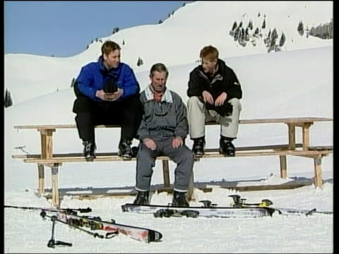 Skiing holiday cEN NICHOLAS OWEN ITN SWITZERLAND Klosters Prince Charles and Prince William along on drag lift TRACK MS SIDE Prince Harry and guide...