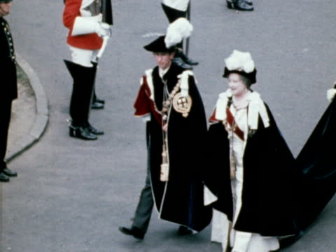 Prince Charles and the Queen Mother wearing regalia of the Knights of the Garter parade through Windsor Castle 1968