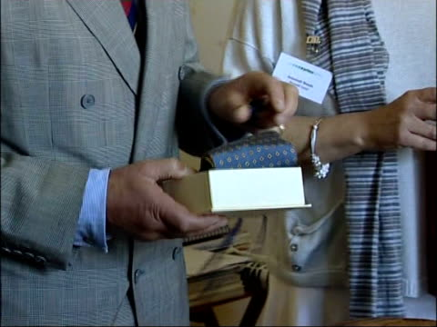 prince charles annual summer tour of wales charles presented with gift by chef struggling to open box and looking at handmade crevat / more of... - struggle stock videos and b-roll footage