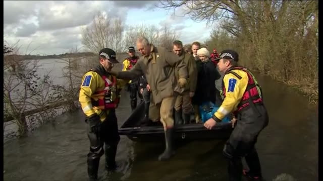 prince charles arrives and greets residents in cutoff village of muchelney during a visit to the flood affected somerset levels - somerset levels stock videos and b-roll footage