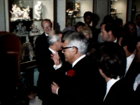 prince charles arrives at a dinner function with cary grant and then stands alongside farrah fawcett and husband lee majors; 1977 - fame stock videos & royalty-free footage