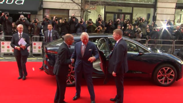 prince charles arriving at the prince's trust awards in london, goes to shake hands then remembers he isn't supposed to and greets with namaste... - event stock videos & royalty-free footage