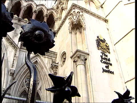 prince charles at centre of blocked publication rumours itn royal courts of justice sign coat of arms on building - publication stock videos & royalty-free footage