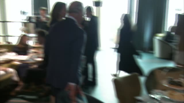 stockvideo's en b-roll-footage met prince charles at reception supporting positive fashion initiative various of prince charles at reception chatting with people from the british... - initiatief