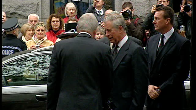 prince charles attends memorial service for 16 men killed in north sea helicopter crash; scotland: aberdeen: ext prince charles and camilla arriving... - aberdeen scotland stock videos & royalty-free footage