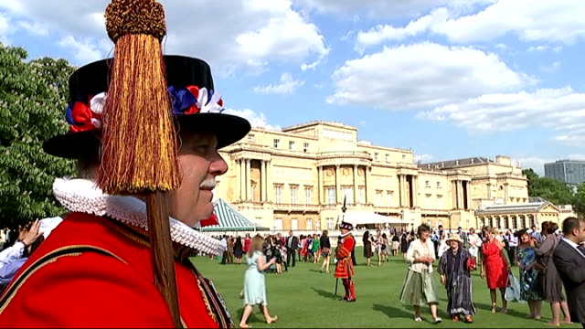 Prince Charles attends Red Cross Garden Party Reporter to camera Beefeaters / Prince Charles along with Sir Nicholas Young and speaking to people /...