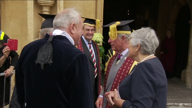 prince charles attends royal agricultural university graduation ceremony england gloucestershire cirencester church of st john the baptist ext prince... - chiesa battista video stock e b–roll