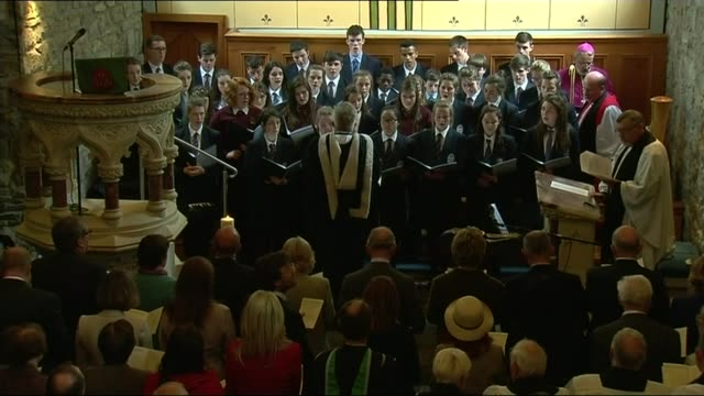 prince charles attends service of peace and reconciliation in drumcliffe congregation and choir singing sot - congregation stock videos and b-roll footage