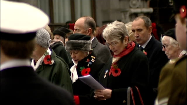 prince charles attends war widows' service at cenotaph; congregation sing hymn sot/ prince charles and others sing national anthem - god save the... - witwe stock-videos und b-roll-filmmaterial