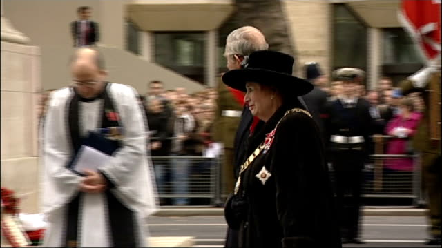 prince charles attends war widows' service at cenotaph; prince charles and baroness fookes along together towards car at end of service/ prince... - witwe stock-videos und b-roll-filmmaterial