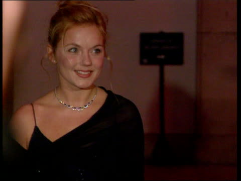 paintings unveiled bnat katie england surrey hampton court palace ext/night i/c geri halliwell posing for photo opportunity on arrival cms joanna... - andrew lloyd webber stock videos and b-roll footage