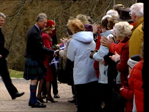 vídeos de stock e filmes b-roll de prince charles & camilla, duchess of cornwall on honeymoon; scotland deeside crathie kirk side lms prince charles along with camilla as greeting... - lua de mel