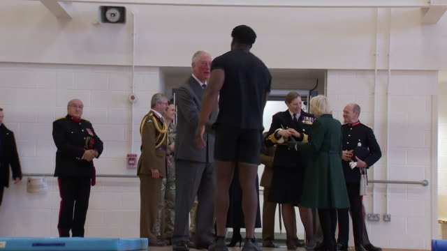 prince charles, camilla, duchess of cornwall, prince william and catherine, duchess of cambridge visiting a gym at a military rehabilitation centre... - son stock videos & royalty-free footage