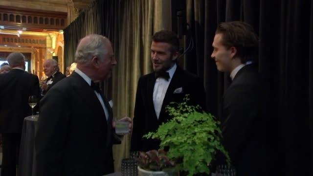 Prince Charles chats to David Beckham and his son Brooklyn at world premiere of David Attenborough new Netflix series Our Planet at the Natural...
