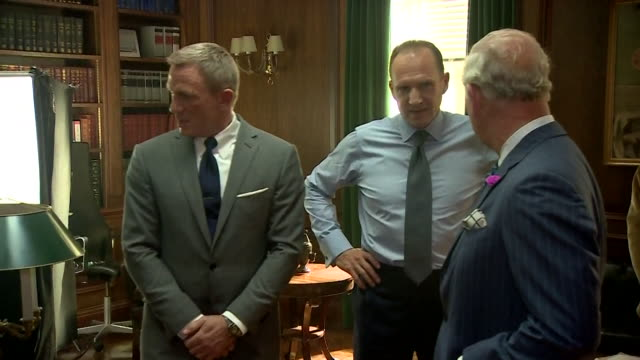 vídeos de stock, filmes e b-roll de prince charles chats with daniel craig and ralph fiennes in q's office on the set of the 25th james bond film at pinewood studios - daniel craig ator