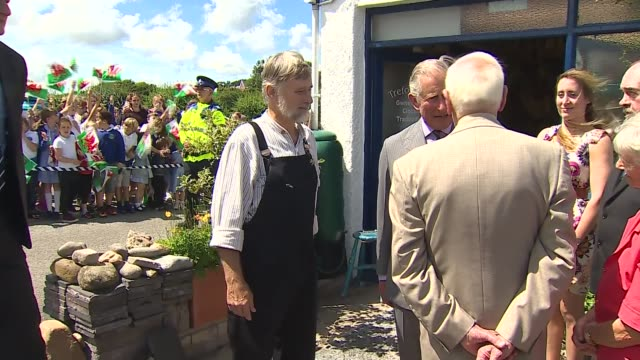 Prince Charles chats with reporter WALES Gwynedd EXT Prince Charles chatting with people outside Trefor Owen ice cream parlour Prince Charles chats...