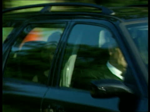 prince charles/ church of england lib highgrove house camilla parker bowles in car as past en route to birthday party photographers - camilla duchess of cornwall stock videos and b-roll footage