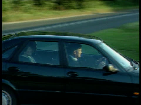 prince charles/ church of england lib highgrove house camilla parker bowles in car as past en route to birthday party - camilla duchess of cornwall stock videos and b-roll footage