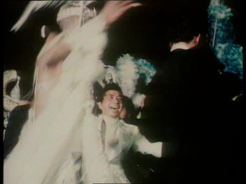 vidéos et rushes de prince charles compilation: part 1; prince charles at the rio carnival - t11037801 tx 11.3.1978 brazil: rio de janeiro: prince charles dancing with... - rio de janeiro