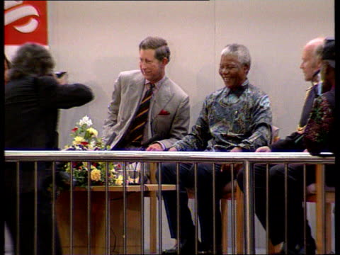 part 1 prince charles divorce and with mandela t12079601 england london brixton int prince charles sat with south african president nelson mandela - nelson mandela stock videos and b-roll footage
