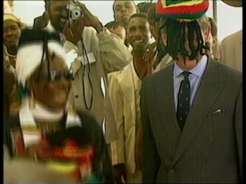 part 2 prince charles visit to jamaica t01030009 prince charles presented with colourful rasta hat fitted with dreadlocks / prince charles dancing as... - rastafarian stock videos & royalty-free footage