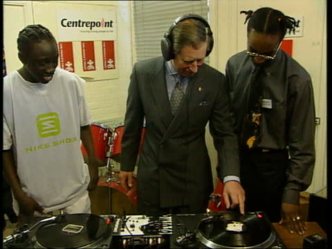 Part 2 The Prince's trust 25th Anniversary T13030108 ENGLAND London INT Prince Charles wearing headphones and mixing records on record decks during...