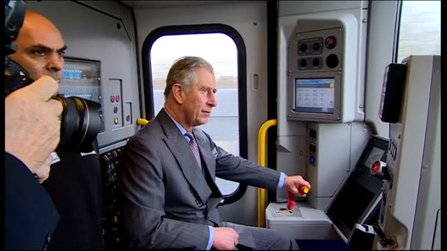 prince charles drives train during visit to bombardier factory in derby england derby photography** prince charles prince of wales driving train... - principe carlo principe del galles video stock e b–roll