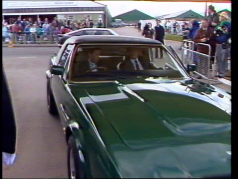 Pagnell TMS Aston Martin towards stops under canopy Prince Charles seen at wheel ZOOM IN TMS Bonnet of Charles Aston Martin INT MS Charles hosts RL...