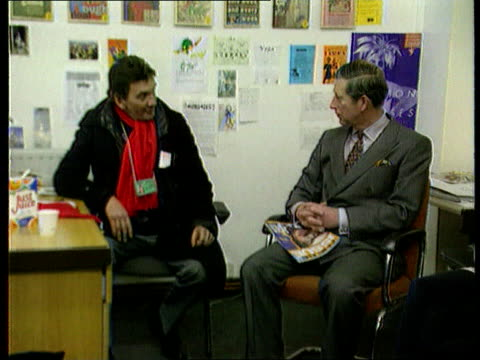 former school friend reunion itn england london clerkenwell 'big issue' offices prince charles chatting 'big issue' sellers and office staff prince... - islington stock-videos und b-roll-filmmaterial