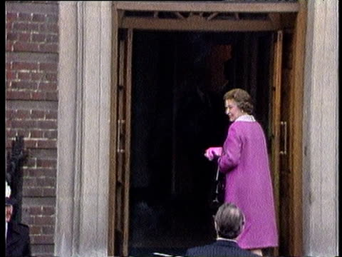 Prince Charles greets Queen Elizabeth II in doorway of St Mary's hospital during visit to meet her newborn grandson Prince William London 22 Jun 82