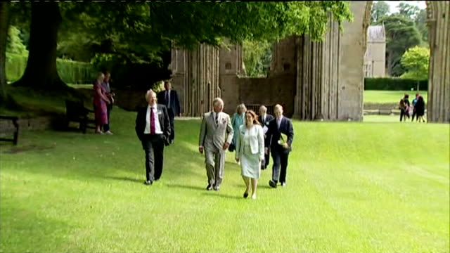 prince charles has been revisiting some of the areas worst affected by flooding earlier this year. crowds gathered in glastonbury to welcome him,... - glastonbury abbey stock videos & royalty-free footage