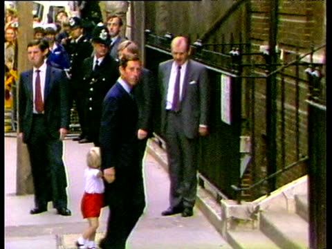 prince charles holds hands with prince william to walk up steps of st mary's hospital to visit newborn baby prince harry london; 16 sep 84 - shorts stock videos & royalty-free footage