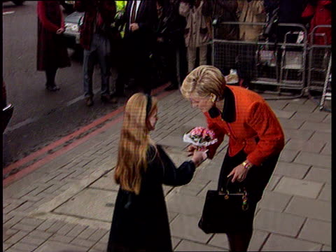 Prince Charles holiday LIB London Euston Rd Princess Diana accepting small bowl of flowers from little girl