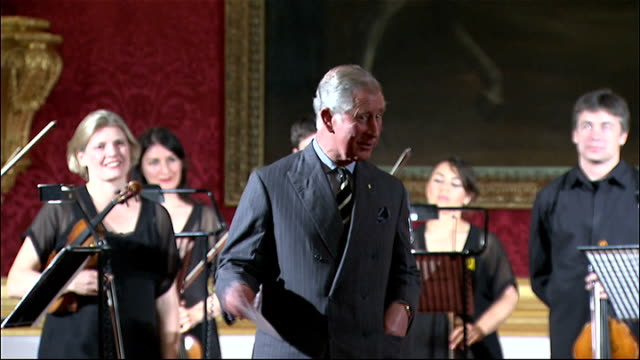 stockvideo's en b-roll-footage met prince charles hosts reception for australian chamber orchestra prince charles speech / prince charles standing with australian chamber orchestra for... - michael parkinson