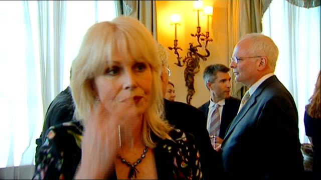 prince charles hosts reception for samaritan supporters joanna lumley interview sot / more of charles mingling with guests / first samaritan... - joanna lumley stock videos & royalty-free footage