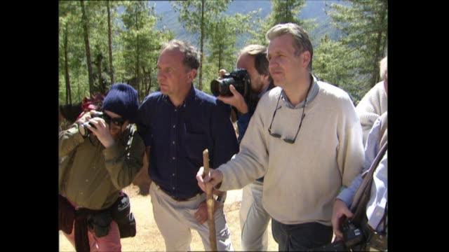 prince charles in bhutan: day three: part two:; bhutan: ext charles on hillside; hillside zoom in to charles; prayer tower as prayer wheels turning;... - 性感染症点の映像素材/bロール