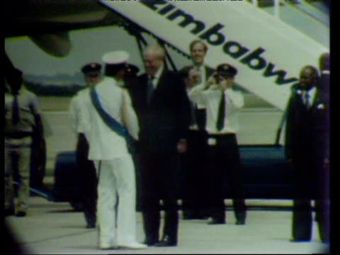Prince Charles is greeted by Prime Minister Robert Mugabe following his arrival in Zimbabwe 1980s