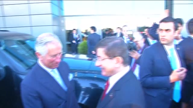 prince charles is welcomed by turkish pm ahmet davutoglu and turkish fm mevlut cavusoglu as he arrives for the high level peace summit on the 100th... - türkischer premierminister stock-videos und b-roll-filmmaterial
