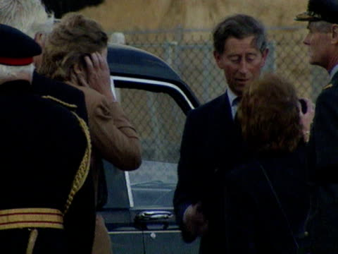 prince charles kisses diana's sisters lady jane fellowes and lady sarah mccorquodale on the cheek as the hearse carrying the body of princess diana... - hearse stock videos & royalty-free footage