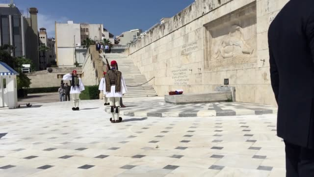 prince charles lays a wreath at the tomb of the unknown soldier in athens camilla arrives at the benaki museum and meets the partner of the greek... - kranz stock-videos und b-roll-filmmaterial