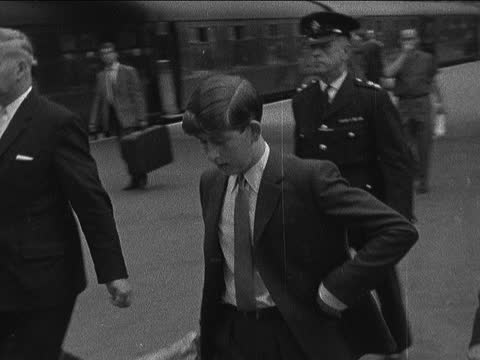 prince charles leaves london; england: london: liverpool street station: int prince charles, prince of wales & man along & past on platform neg 16mm... - itv evening bulletin stock videos & royalty-free footage