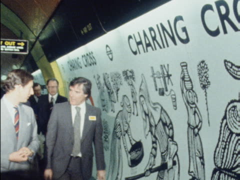 prince charles looks at the decorative mosaics on the platform at charing cross tube station during the opening ceremony of the jubilee line - charing cross stock videos and b-roll footage