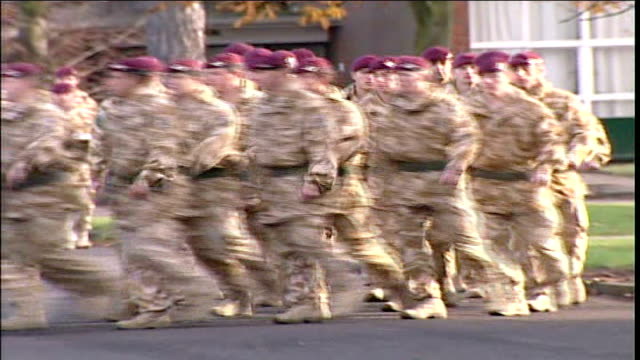 Prince Charles medal ceremony Parachute Regiment troops marching on parade ground/