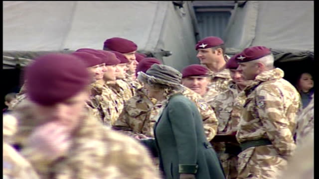 Prince Charles medal ceremony Vars Camilla Duchess of Cornwall along line of troops talking to some of them and handing out medals