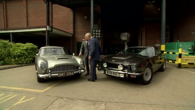 Prince Charles meets Daniel Craig and looks at the James Bond cars on the set of the 25th Bond film at Pinewood studios