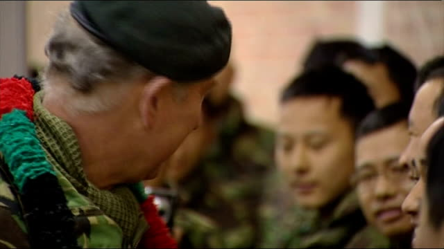vídeos y material grabado en eventos de stock de prince charles meets gurkha soldiers and their families more of charles meeting gurkhas shaking hands and chatting / charles trying on rucksack - gurkha