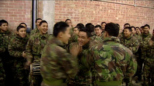 vídeos y material grabado en eventos de stock de prince charles meets gurkha soldiers and their families **music heard sot** gurkha soldiers dancing singing and playing drums sot / prince charles... - gurkha