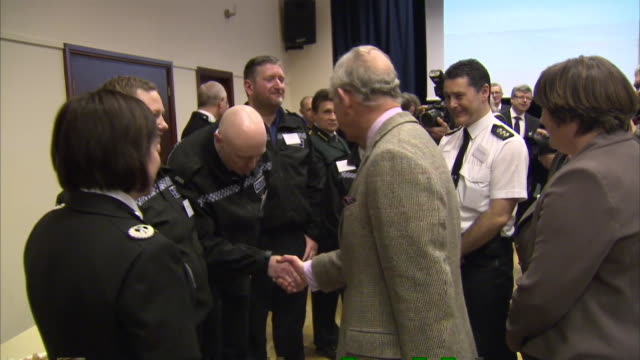 prince charles meets with emergency services personnel at a local hall in the somerset town of stoke st gregory during his tour of the flood affected... - somerset levels stock videos and b-roll footage