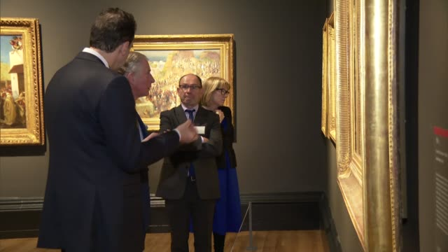 prince charles national gallery visit; prince charles looking around exhibition with curator and studying paintings on display / charles along inside... - curator stock videos & royalty-free footage