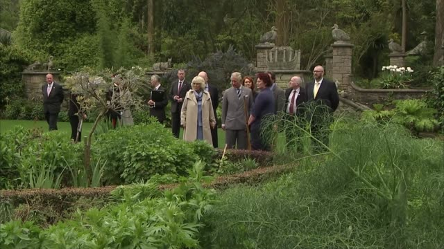 Mount Stewart House Charles and Camilla out of house and along in garden / Charles and Camilla chat to staff / close shot Charles / more of couple...